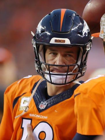 Denver Broncos quarterback Peyton Manning (18) looks