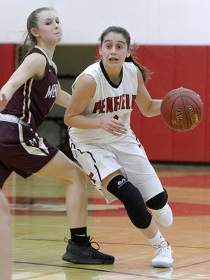 Penfield's Baylee Teal, right, drives past Pittsford Mendon's Courtney Naugle during a regular season game played at Penfield High School, Tuesday, Dec.12, 2017. Pittsford Mendon beat Penfield 68-62 in overtime.