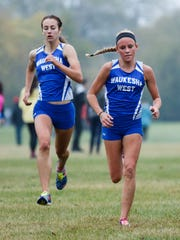 Waukesha West senior Becca Langer (left) catches teammate Brooke Lytle on the final straight for a sixth place finish in the Classic 8 Conference Championship cross country meet at Lake Denoon Middle School in Muskego on Saturday, Oct. 14, 2017.
