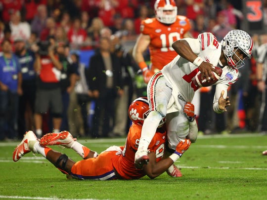 Clemson Tigers defensive end Clelin Ferrell (99) sacks Ohio State Buckeyes quarterback J.T. Barrett (16) during the third quarter of the College Football Playoff Semifinal game in the PlayStation Fiesta Bowl on Dec. 31, 2016 at University of Phoenix Stadium in Glendale, Arizona.