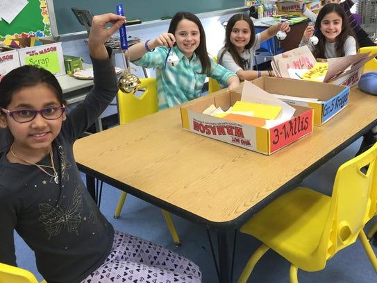 Third graders at Wilson School show the simple bells