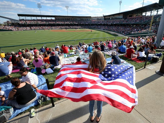 The Indianapolis Indians game on the 4th of July is always a good summertime tradition. This game on the Indians schedule is one of the first to sell out. Here Sophie Putrim, from suburban Chicago, waves the American Flag in the early innings of the Indians game against the Louisville Riverbats. Matt Kryger / The Star
