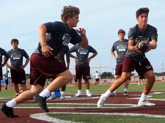 Calallen's players work on drills during the first day of football practice on Monday, Aug. 7, 2017, at Calallen High School in Corpus Christi.