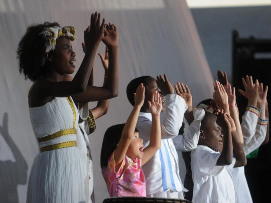 His Little Feet, an international children's choir, performs on the grandstand during Lifest, a large Christian music festival, in Oshkosh, Wis., on Friday, July 12, 2013. The choir is made up of children from China, Ethiopia, Haiti, South Korea and the United States.