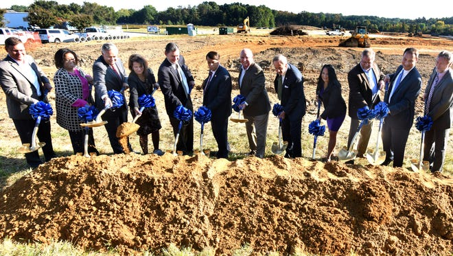 Chesapeake Utilities president and CEO Michael McMasters (center) is flanked by Dover Mayor Robin Christensen and U.S. Sen. Tom Carper, D-Del., at the ceremonial ground breaking for the company's new business campus in Dover.