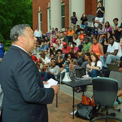Clemson chief of staff Max Allen tells the crowd the