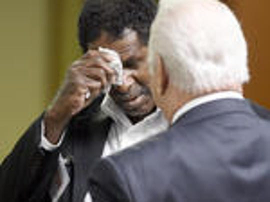 Lawrence McKinney, left, with attorney Jack Lowery Sr., right, at a Tennessee Board of Parole Hearing in September 2016.