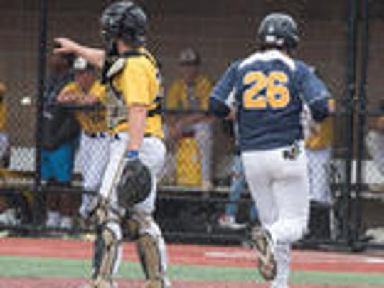 Sam Angelo (26) of Toms River North  crosses the plate with the game's first run. Monmouth Regional played Toms River North in the semifinals of the Shore Conference Baseball Tournament on Wednesday. Game was played at the Count Basie Theater in Red Bank. Russ DeSantis/correspondent