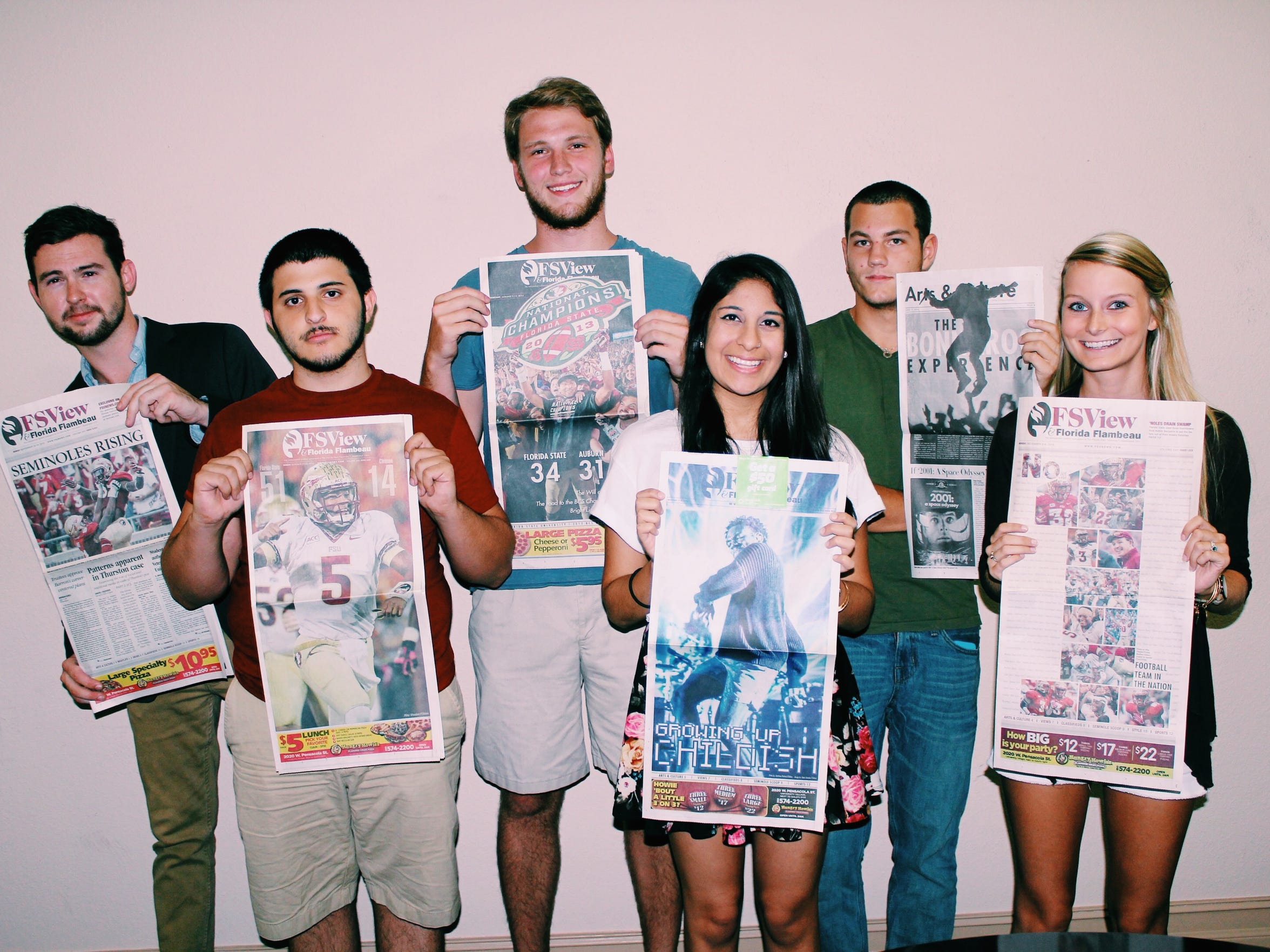 The FSView staff poses with some of our favorite covers.