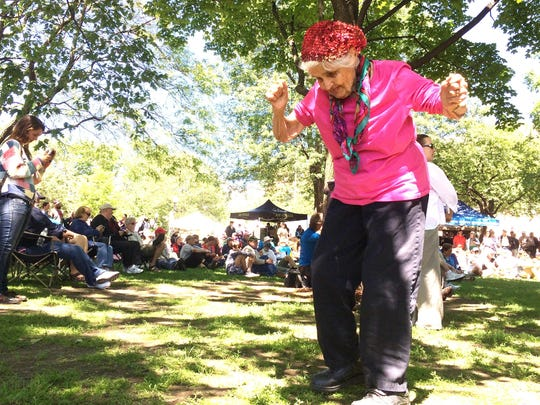 Stella Penzer de domo Stawin, 90, romps to the rhythms of The Wee Trio on Saturday in City Hall Park. The three-band event celebrated Big Joe Burrell Day at the Burlington Discover Jazz Festival.