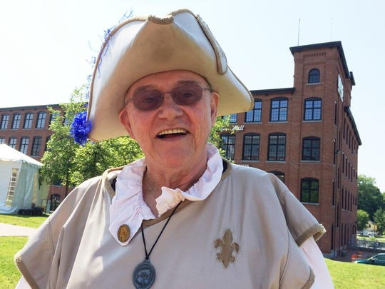 Jon Normandin, 68, of Burlington, greets a visitor Saturday to French Heritage Day in Winooski.