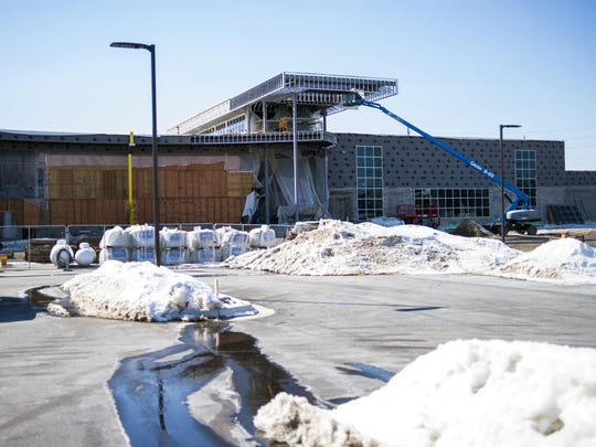 This May 8, 2019 photo shows construction at the Flint Cultural Center Academy in Flint, Mich.
