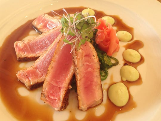 The Sandy Parrot serves ahi tuna seared rare on a bed of wakimi slaw, pickled ginger and microgreens.