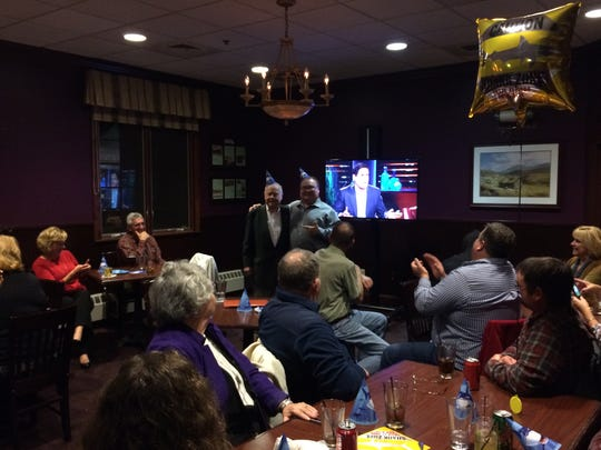 "Curt Campbell and his 88-year-old father are surrounded by family and friends Friday night at St. Brendan's Inn in Green Bay for a watching party of Campbell's appearance on ABC's ""Shark Tank."""