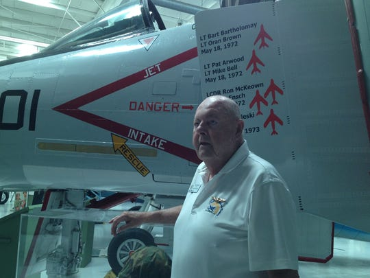 Bill Griffin, a retired United States Marine Corps major, stands next to a F4 Phantom fighter jet on display at the Palm Springs Air Museum where he is a volunteer docent. Griffin, of Rancho Mirage, flew a Phantom in the Vietnam War.