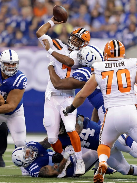 Cleveland Browns quarterback DeShone Kizer (7) is hit as he throws by  Indianapolis Colts 2ebb4f8e7
