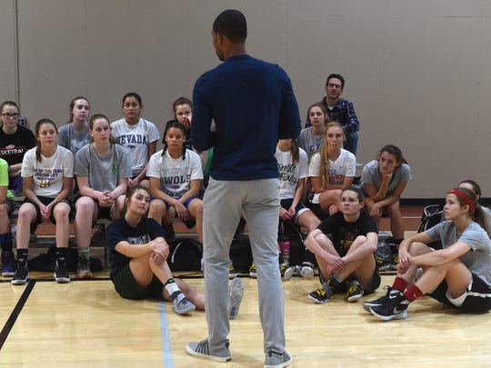 Wolf Pack basketball player Ramon Sessions speaks to area students at South Reno Athletic Club on Wednesday.