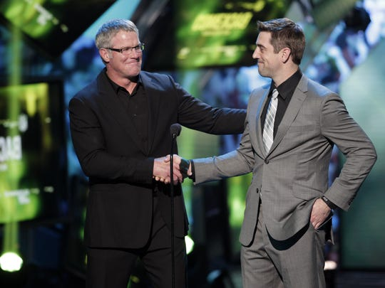 "Brett Favre, left, and Aaron Rodgers present at the 2013 ""NFL Honors"" award show in New Orleans."