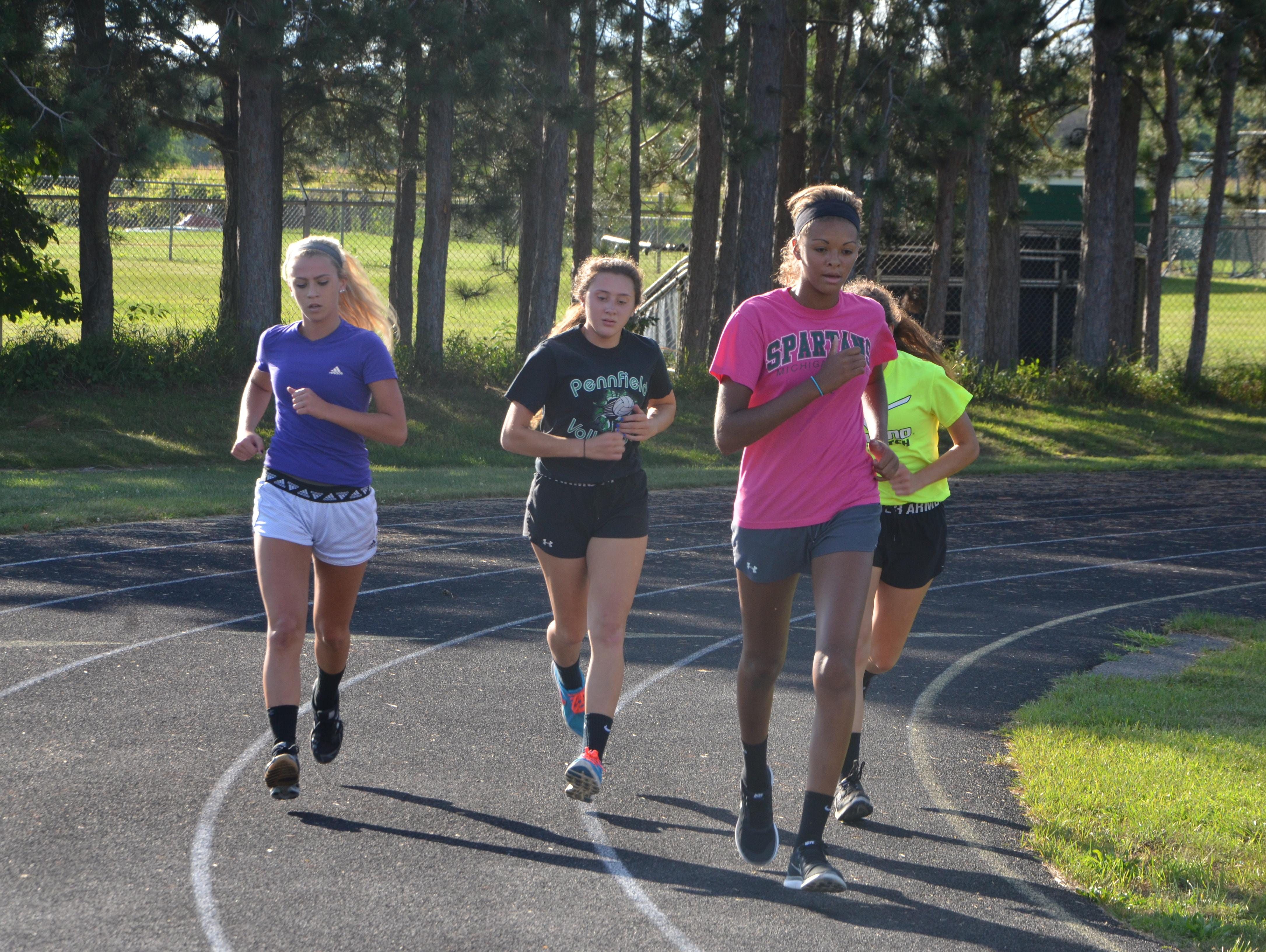 Members of the Pennfield volleyball team run a mile as part of the first practice of the season on Wednesday.