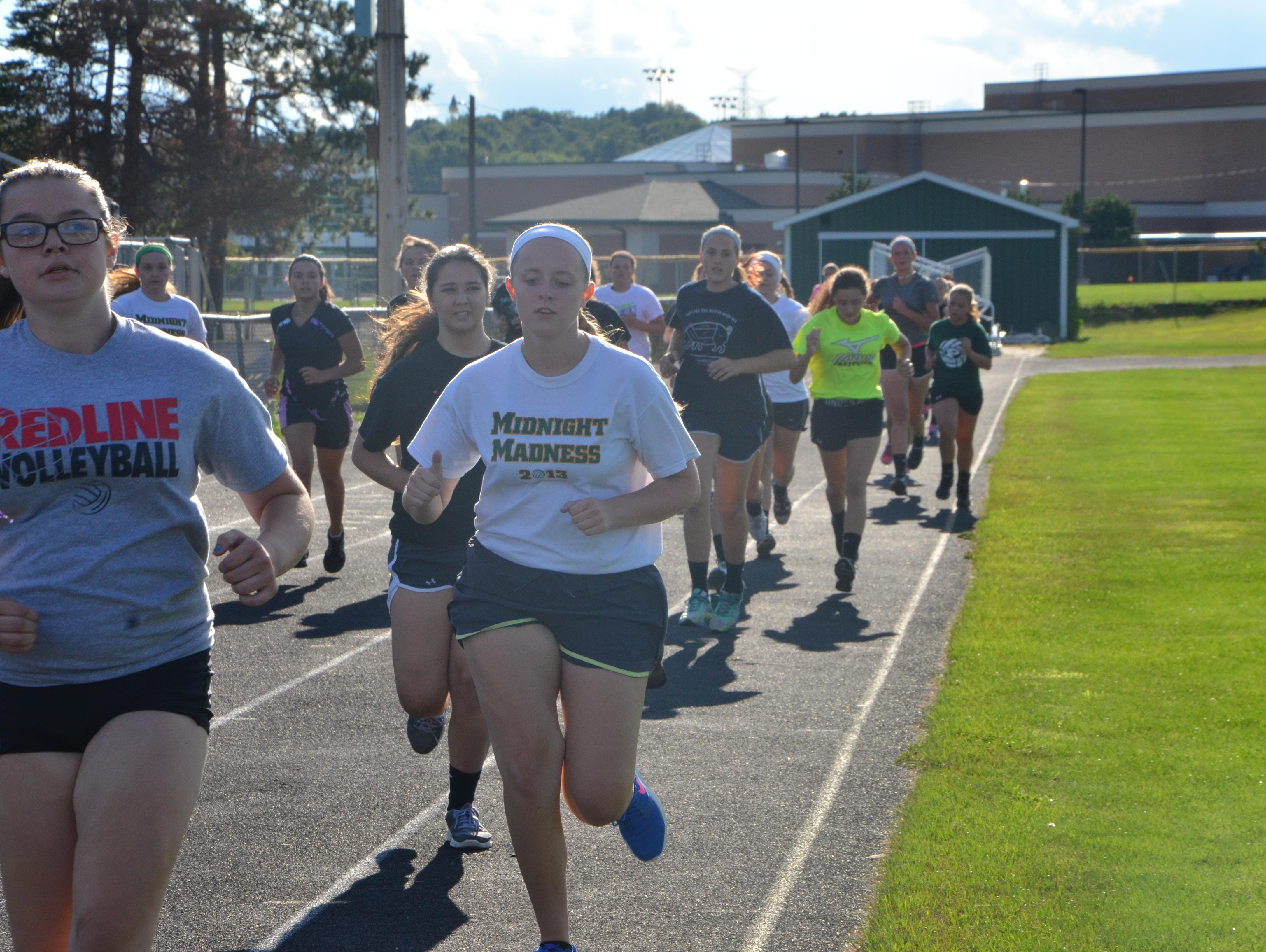 The Pennfield volleyball team runs the track during the first practice of the season on Wednesday.