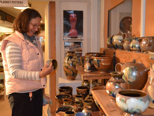 Stephanie Chapman of Woodstown looks at the pottery