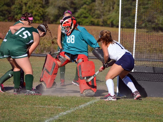 Holly Grove goalie Aron Lankford (88) makes a save during an Eastern Shore Independent Athletic Conference field hockey playoff game on Wednesday, Oct. 21, 2015 versus Gunston Day School. Holly Grove won the game 2-0.