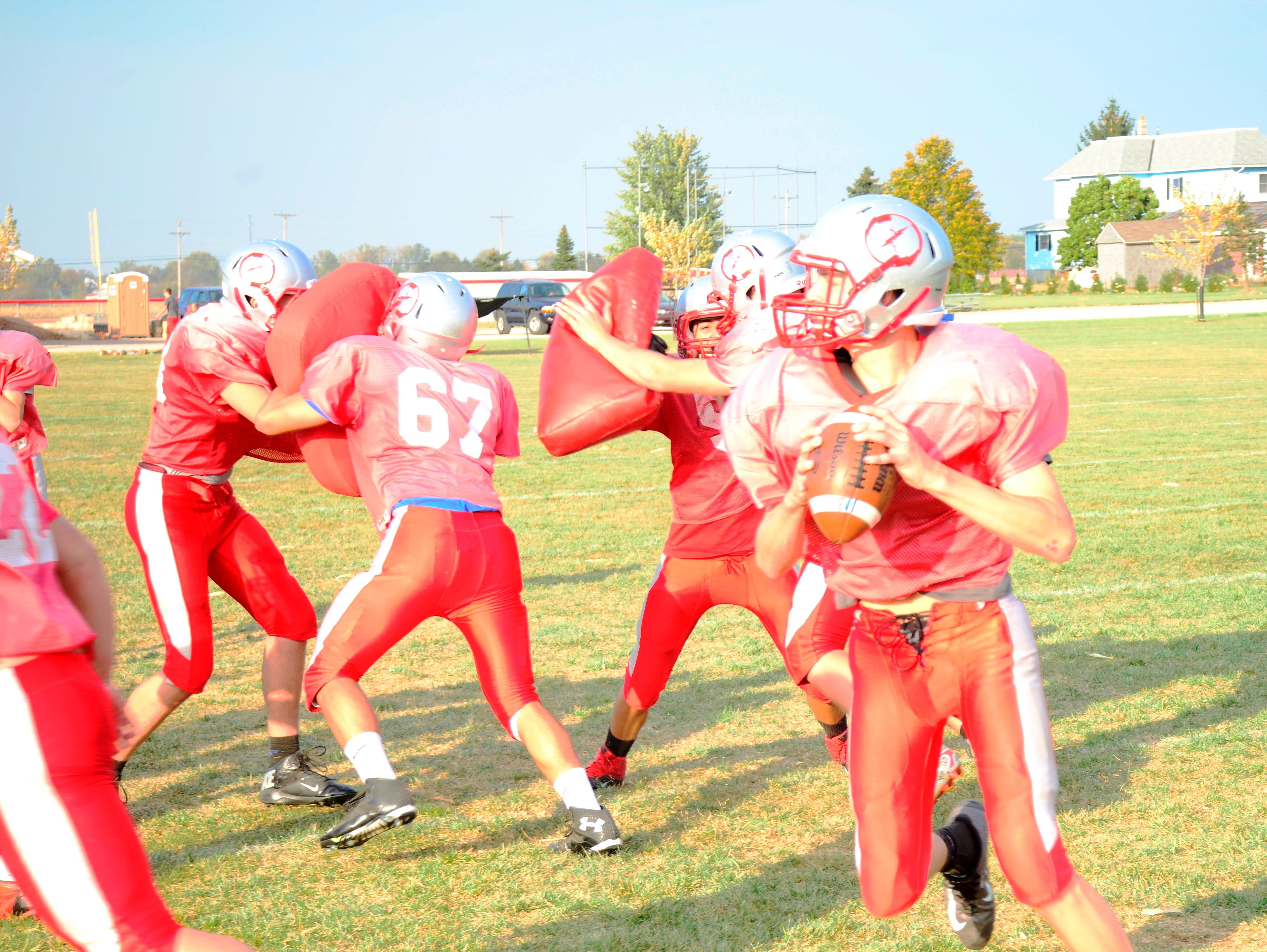 St. Joseph Central Catholic quarterback Spencer Harrison looks for an open receiver during the Crimson Streaks' practice Wednesday. SJCC will host Lakota at Don Paul Stadium Saturday.
