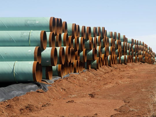 In this Feb. 1, 2012, file photo, miles of pipe for