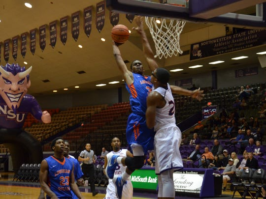 LC senior A.J. Gaines (35, center) throws down a dunk against Northwestern State Wednesday.