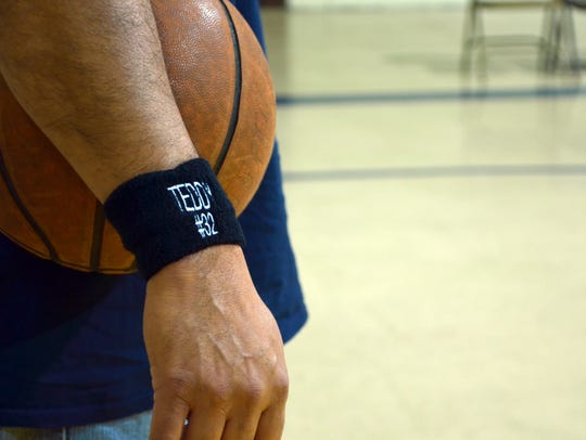 First Baptist coaches and players wore black wristbands
