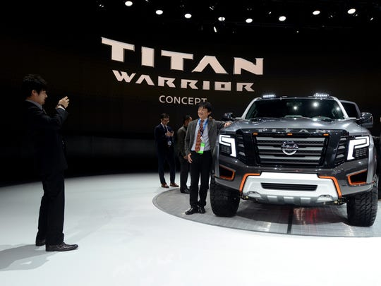 The Nissan Titan Warrior concept poses with event goers for photos Tuesday, Jan. 12, during the North American International Auto Show at Cobo Hall.