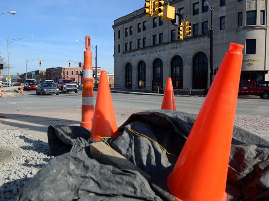 Cones line the street Monday, Jan. 25, at the intersection of Water and Military Streets in Port Huron.