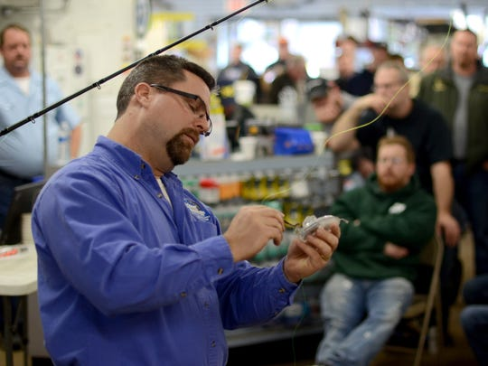 Fisherman Dan Fenner talks about spring fishing techniques Sunday, Feb. 21, during the annual Fish Church series at Anderson's Pro Bait in Port Huron.