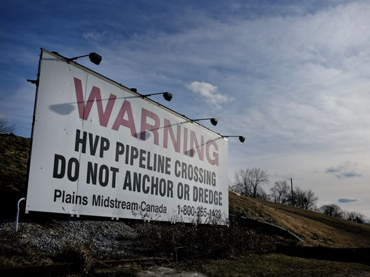 A sign in 2014 warns boaters of pipelines under the
