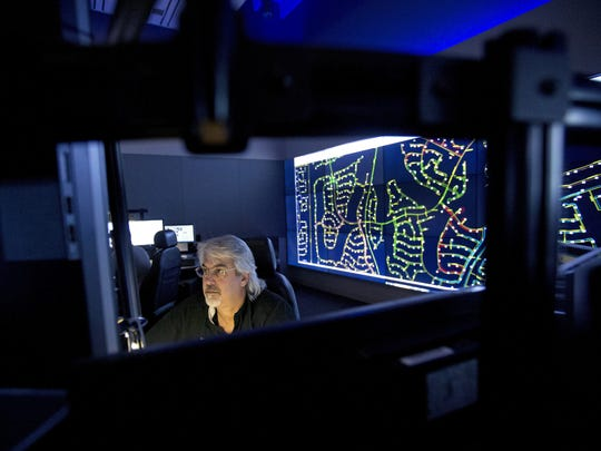 APS operator Dennis Barksdale monitors a power grid