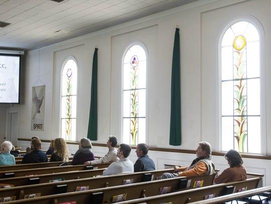 Congregants listen to Rev. James Pennington (not pictured)