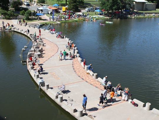 Families gather at the Concho River for fishing and