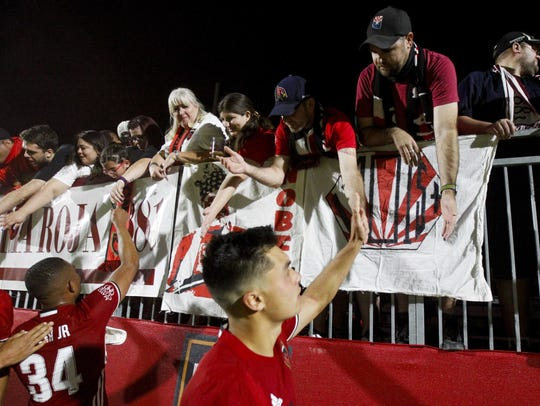 Phoenix Rising FC players greet fans after a 1-0 loss