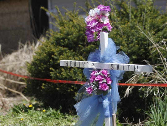 A makeshift memorial to Heather Smith stands in front