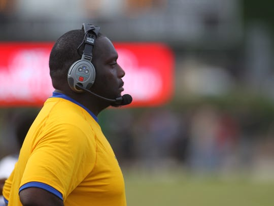 Rickards head coach Quintin Lewis roams the sidelines
