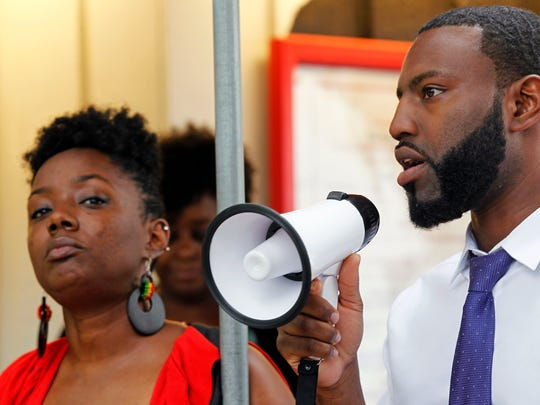 State Representative David Bowen, right, speaks to a crowd who gathered for a vigil following the aftermath of an officer involved shooting at the Lake Front on Lincoln Memorial Drive in Milwaukee on Monday, June 12, 2017. On the left is organizer Markasa Tucker from UBLAC, Uplifting Black Liberation and Community.