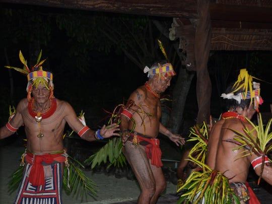 Mentawais Shamans perform traditional style of dances.