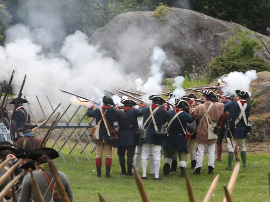 American soldiers fire during a battle re-enactment