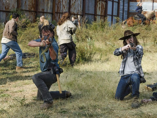"Andrew Lincoln stars as Rick Grimes, left, and Chandler Riggs as Carl Grimes in ""The Walking Dead."" The eighth season premieres on Sunday, Oct. 22."