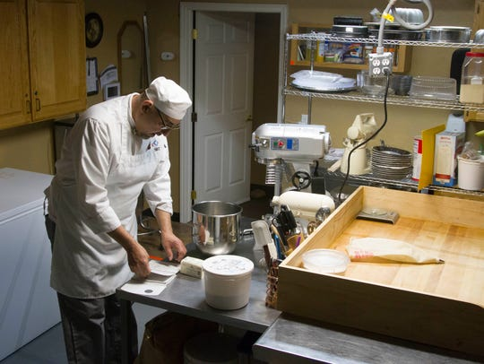 Dan Ortega works on a recipe at the Papa D's Bakery