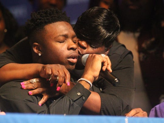 Godby linebacker Treon Patrick gets a kiss from his mom as he breaks down while signing with Alcorn State on national signing day.