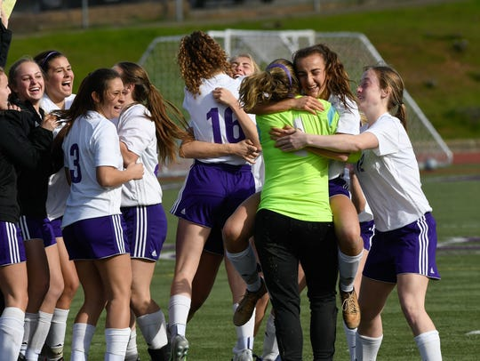 Shasta High's soccer players celebrate Saturday after