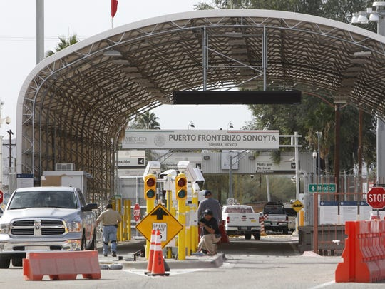 Workers finish upgrades at the Lukeville-Sonoyta border crossing in December 2017 to make the two southbound lanes reversible as a way to tackle long wait times during spring break and other busy travel days.
