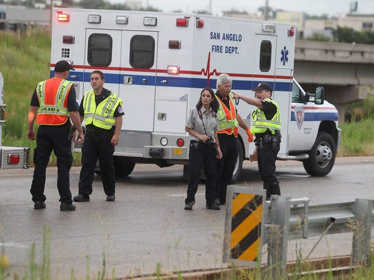 San Angelo police and crime scene investigators tag evidence along the 4500 block Houston Harte Expressway after the body of Gisele Jarmon was found along the frontage road June 16, 2015.