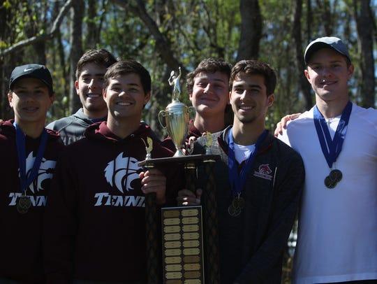Chiles' boys tennis team celebrates a 2018 city title.